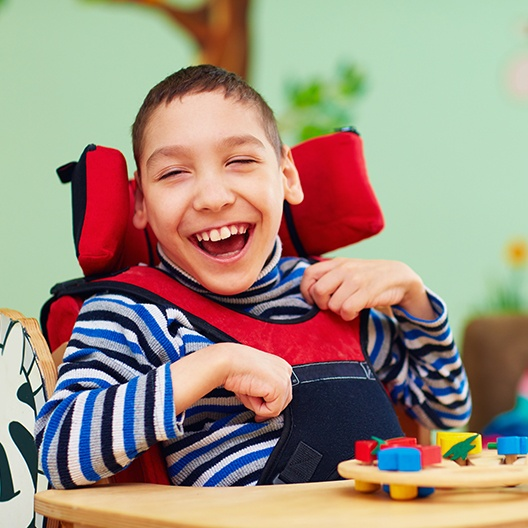 Laughing child in wheelchair