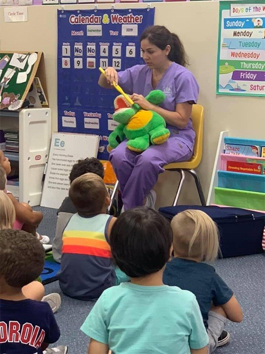 Dental team member Brittany visiting school kids for oral health education