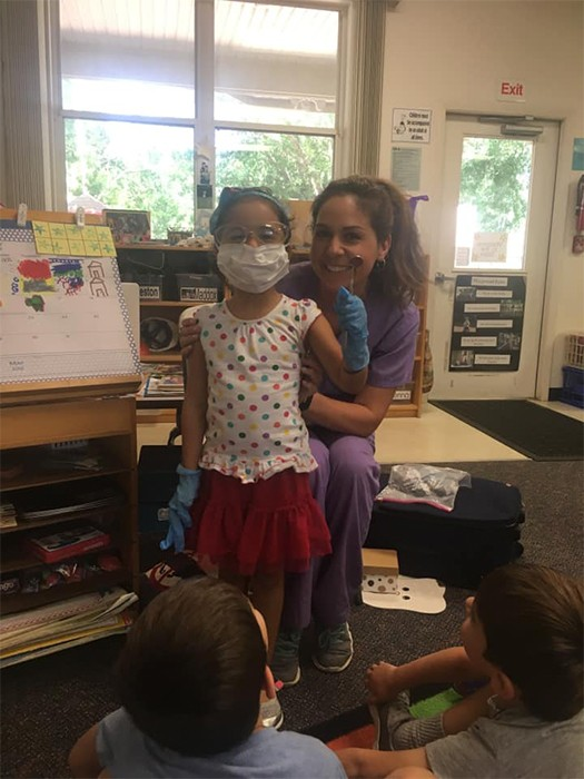 Dental team member teaching kids about dentistry