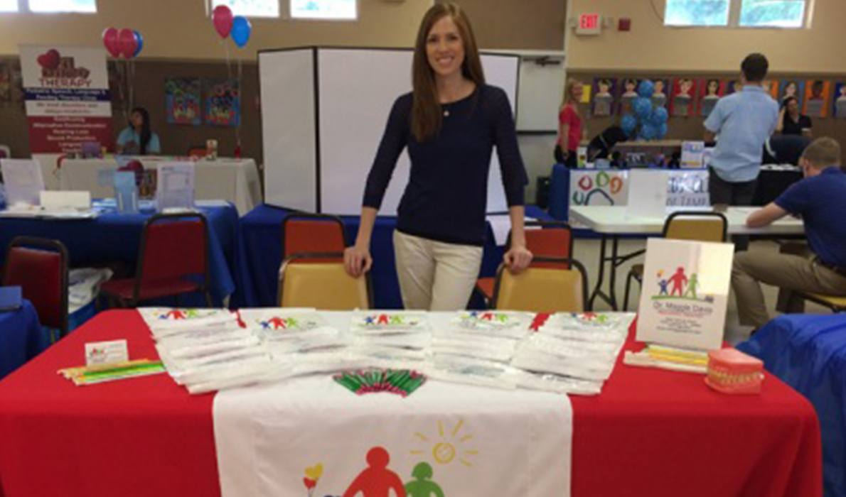 Team member at Morningstar School Family Fun and Resource fair