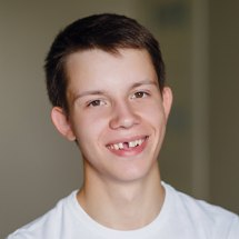 Preteen boy with missing front tooth smiling