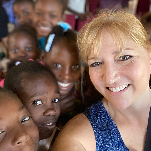 Doctor Maggie on mission trip in Haiti