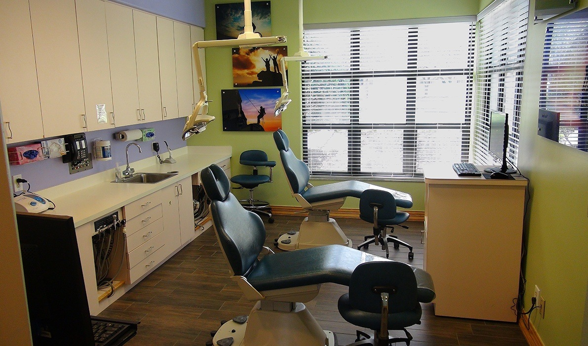 Two dental chairs in the same room