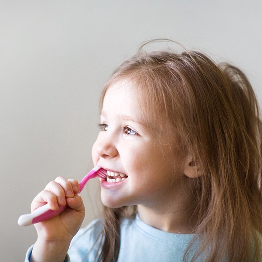 Closeup of child brushing her teeth