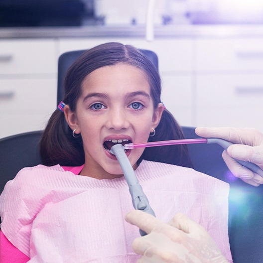 Dentist capturing images of child's smile
